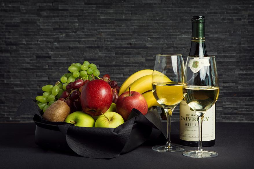 Fruit basket and white wine